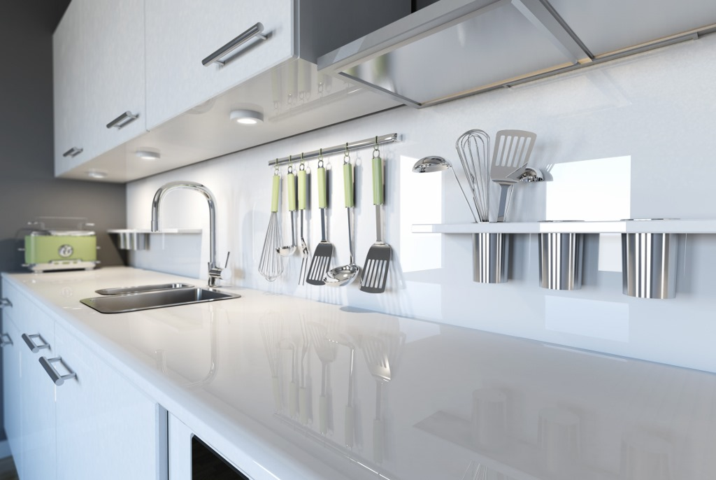 modern white on white multi family apartment kitchen
